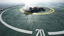 Coulthard celebrates Red Bull's F1 triumph by doing donuts on Burj Al Arab hotel helipad [video]