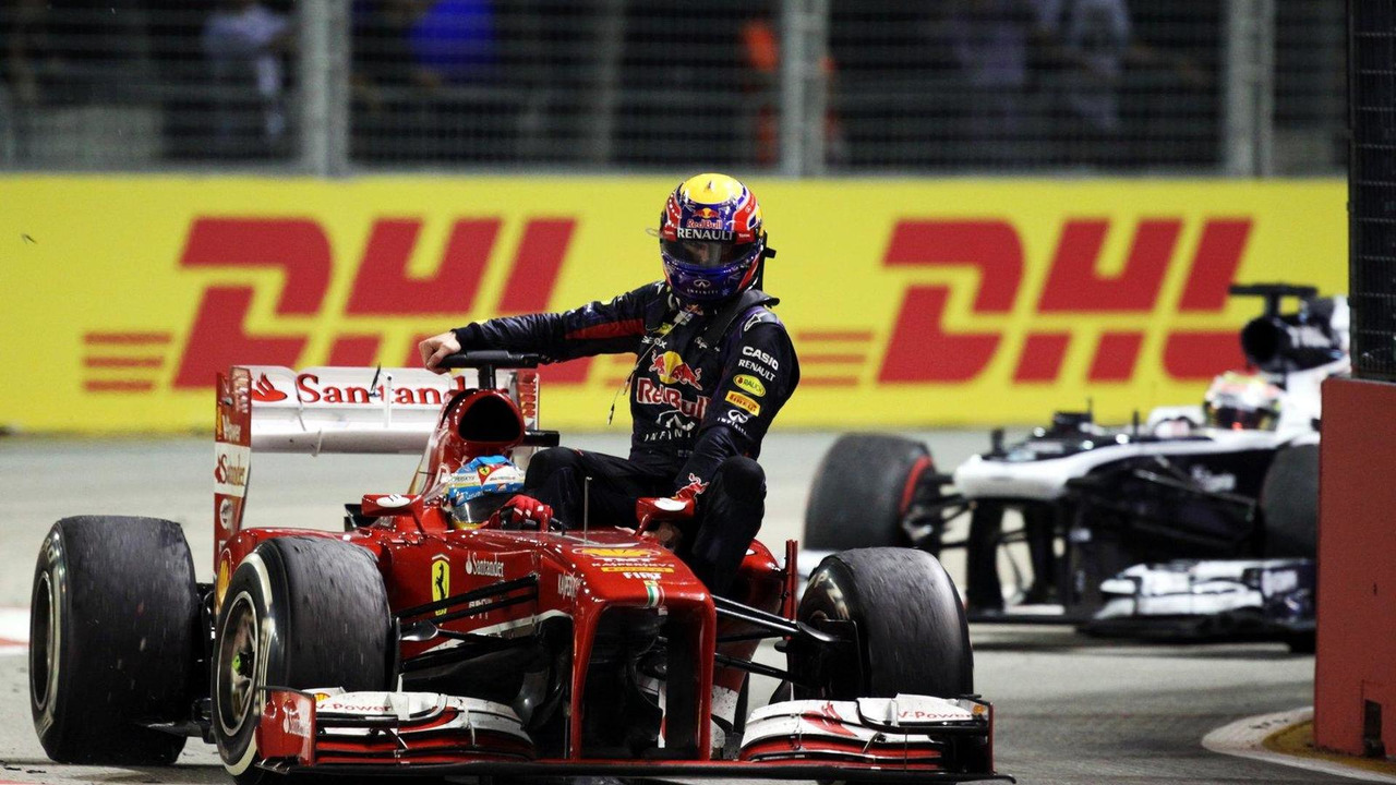 Fernando Alonso gives race retiree Mark Webber a lift back to the pits at the end of the race 22.09.2013 Singapore Grand Prix
