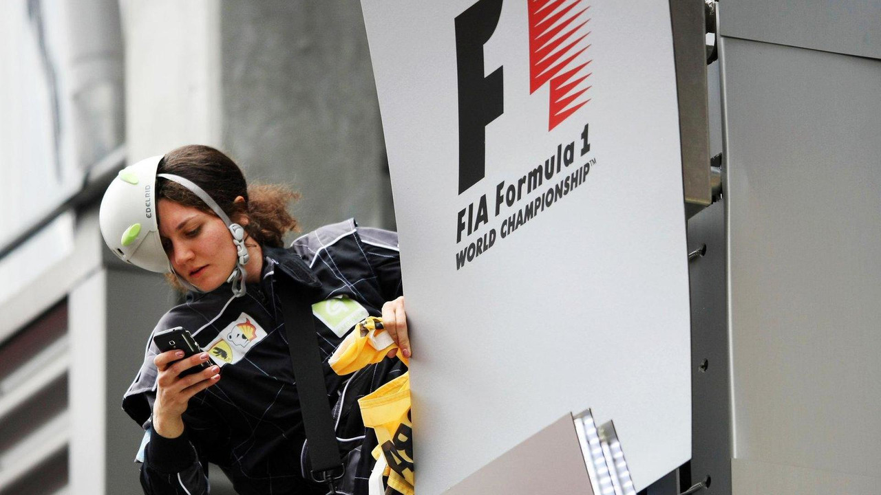 Greenpeace activist Julia F makes protest against race title sponsors Shell at the podium 25.08.2013 Belgian Grand Prix