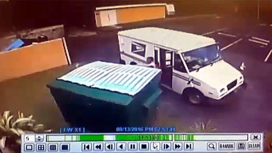 U.S. postal worker throws mail in dumpster