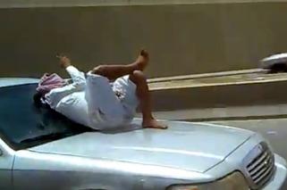 Saudi Man Texting While On Hood Of Car [video]