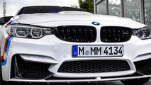 BMW M4 with M Performance parts at Abu Dhabi Motors dealership