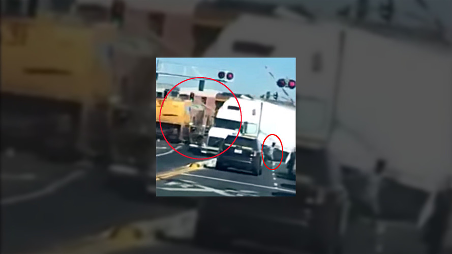Driver jumps from truck just before being smashed by train