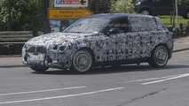 2011 BMW 1-Series spied with wheel force testing apparatus