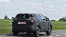 Nissan teases 2014 Qashqai with camouflaged prototypes