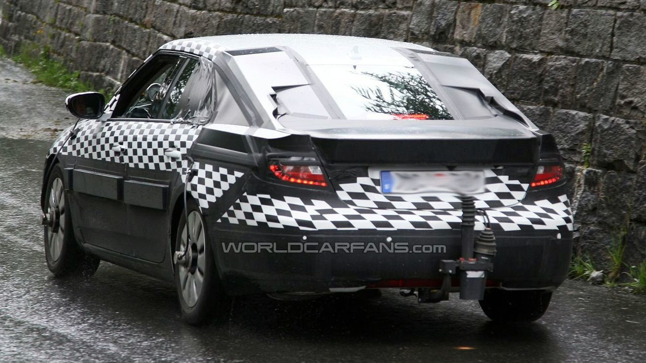 2010 Saab 9-5 sedan spy photos in the Alps