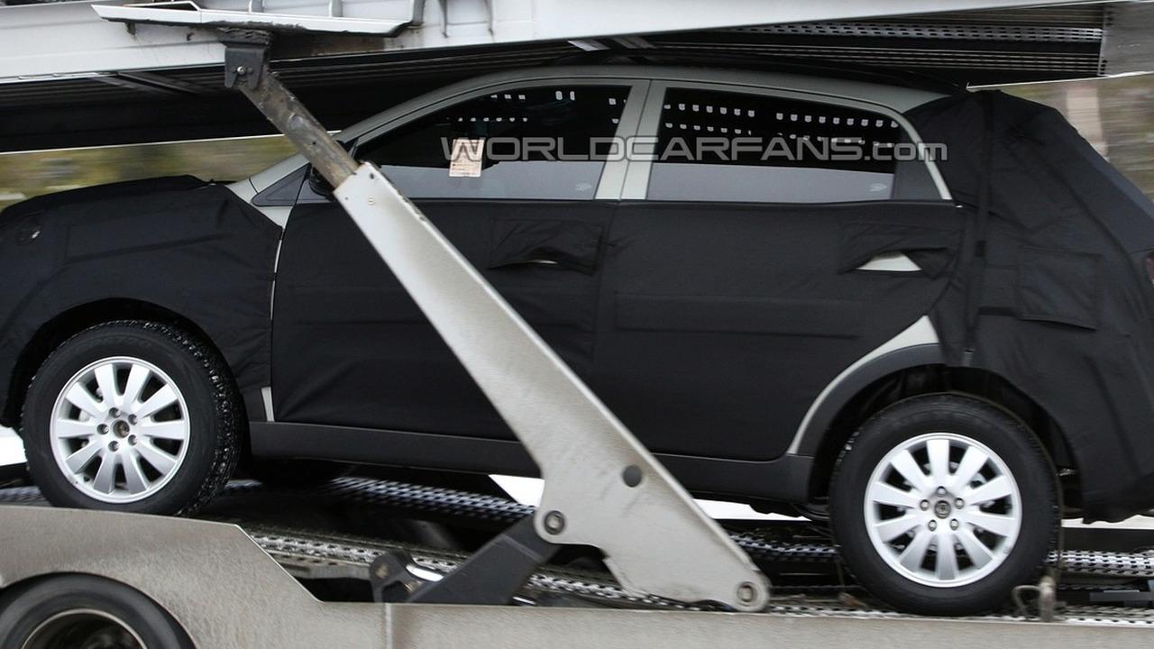 Kia Sportage Spied on Transporter Truck