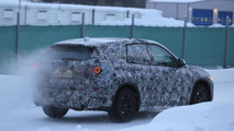 Longer and lower 2015 BMW X1 spied testing front-wheel drive system