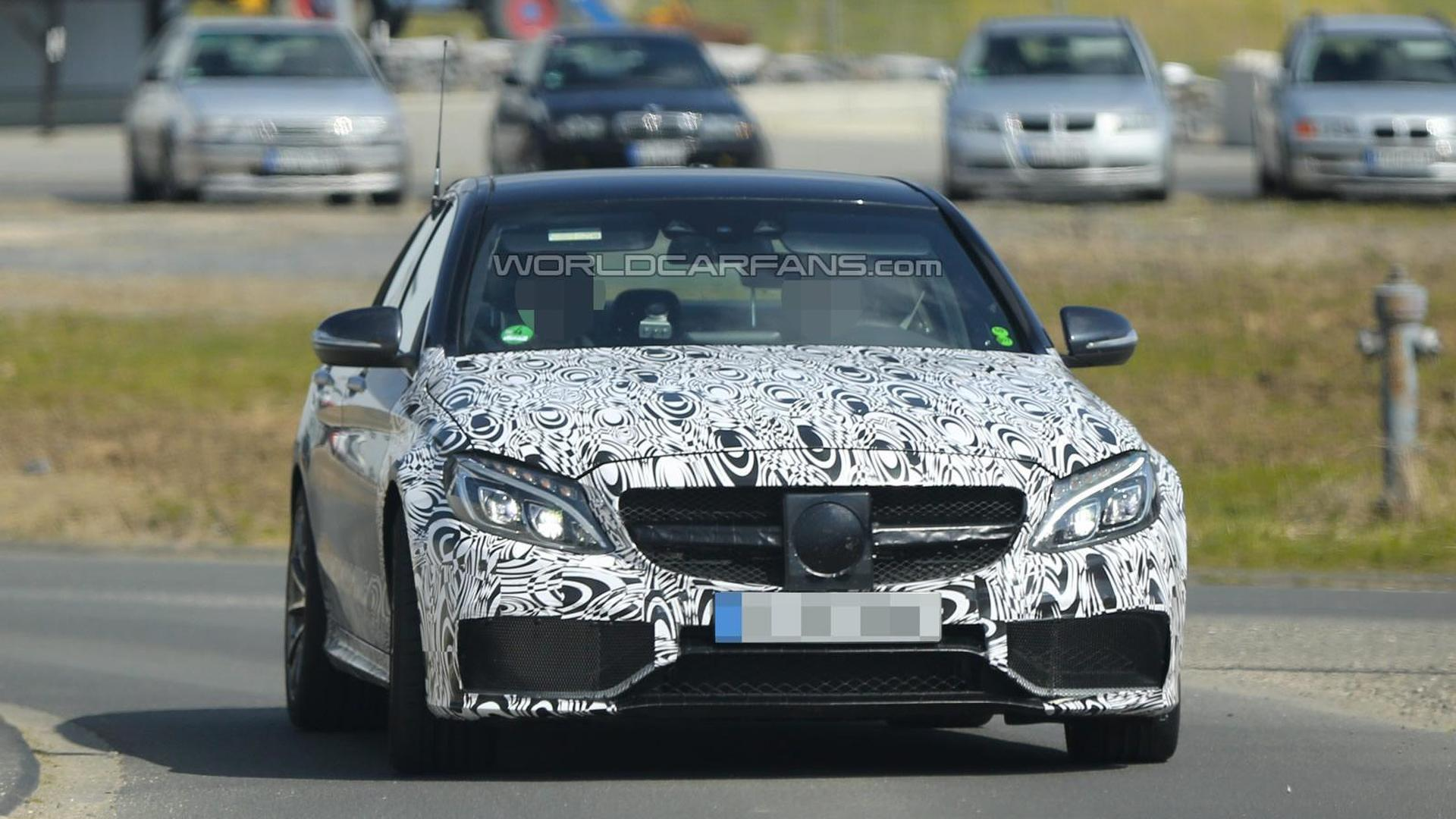 Mercedes-Benz C63 AMG sedan spied wearing less camo on front bumper