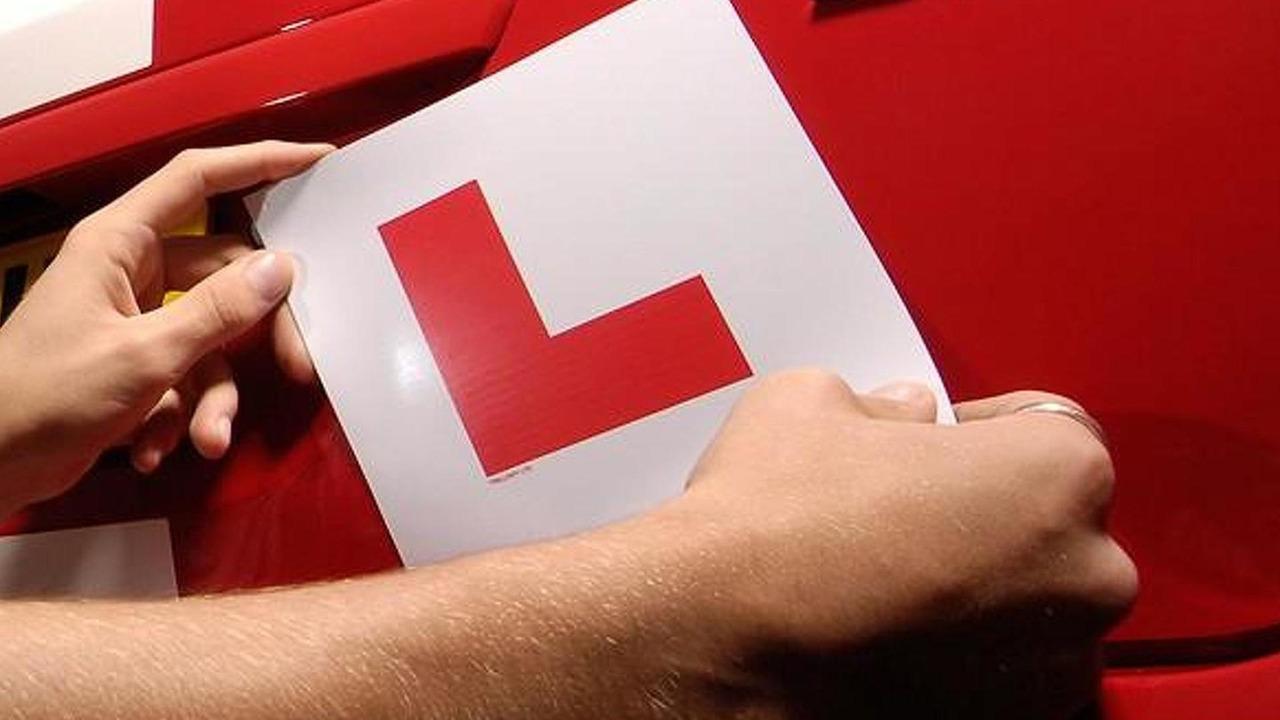 L plate (for learner driver under instruction)