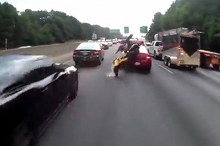 Watch This Lane Splitting End in Horrific Crash
