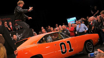 John Schneider appeared at the auction of his General Lee to see it raise $450,000
