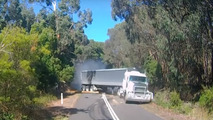 Footage with semi truck jackknifing on downed tree is utterly scary