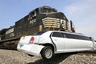 See Train Barrel into Limousine Stuck on the Tracks