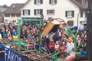 Watch a Crazy Parade Float with a Working Roller Coaster
