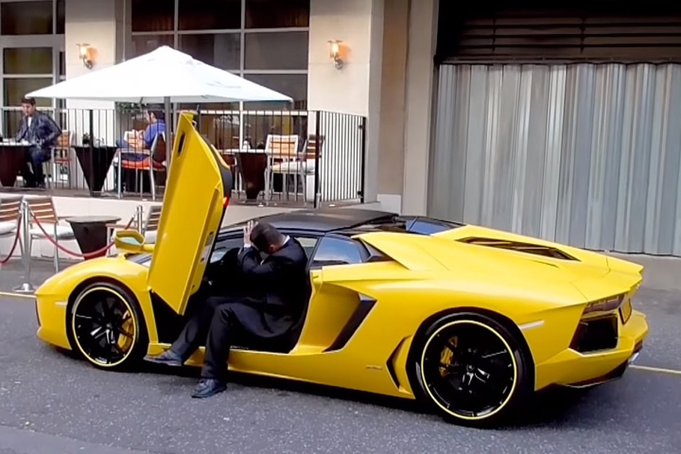 Watch a Too-Tall Valet Try to Fit Into a Lamborghini