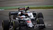Fernando Alonso, McLaren MP4-31 and Sergio Perez, Sahara Force India F1 VJM09