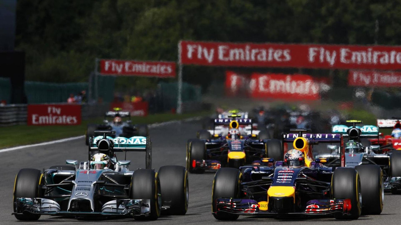 Lewis Hamilton (GBR) and Sebastian Vettel (GER) battle for position at the start of the race, 24.08.2014, Belgian Grand Prix, Spa Francorchamps / XPB