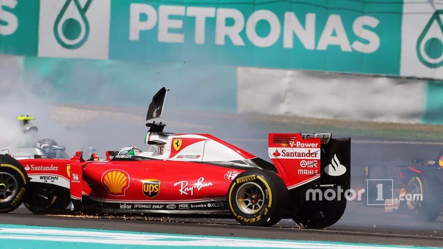 Sebastian Vettel, Ferrari SF16-H and Nico Rosberg, Mercedes AMG F1 W07 Hybrid collide at the start of the race