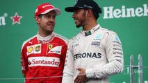 Sebastian Vettel with race winner Lewis Hamilton