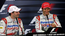 Timo Glock and Jarno Trulli enjoy the post-qualifying FIA Press Conference in Bahrain 2009