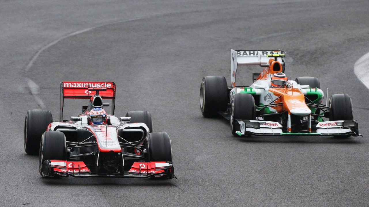 Jenson Button leads Nico Hulkenberg 25.11.2012 Brazilian Grand Prix