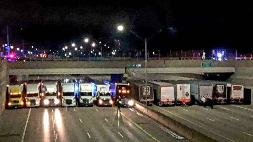 13 Truckers Curb Suicide Attempt On Michigan State Highway