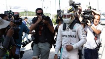Lewis Hamilton, Mercedes AMG F1 returns to the pits after he retired from the race