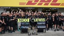 Nico Rosberg, Mercedes AMG F1 and team mate Lewis Hamilton, Mercedes AMG F1 celebrate the Constructors title