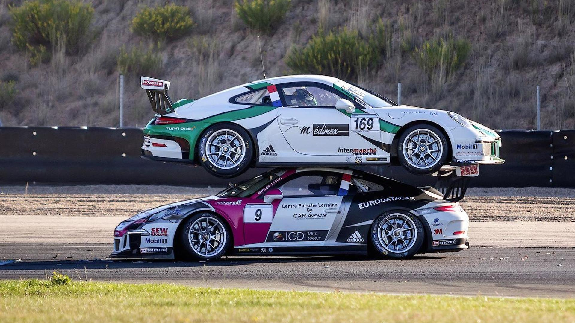 Porsche 911 GT3 racecar ends on top of another 911 GT3 at Carrera ...