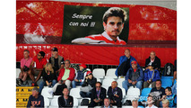 Fans in the grandstand with a banner for Jules Bianchi