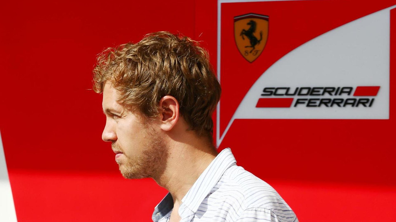 Sebastian Vettel (GER) leaves the Ferrari garage, 25.11.2014, Formula 1 Testing, Day One, Yas Marina Circuit, Abu Dhabi / XPB