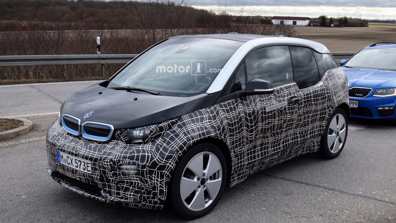 bmw i3 facelift spied with lowered suspension is it the i3s. Black Bedroom Furniture Sets. Home Design Ideas