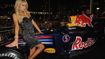 Paris Hilton poses by a Red Bull Formula 1 car during a party at the Red Bull Energy Station on May 16, 2010 in Monaco