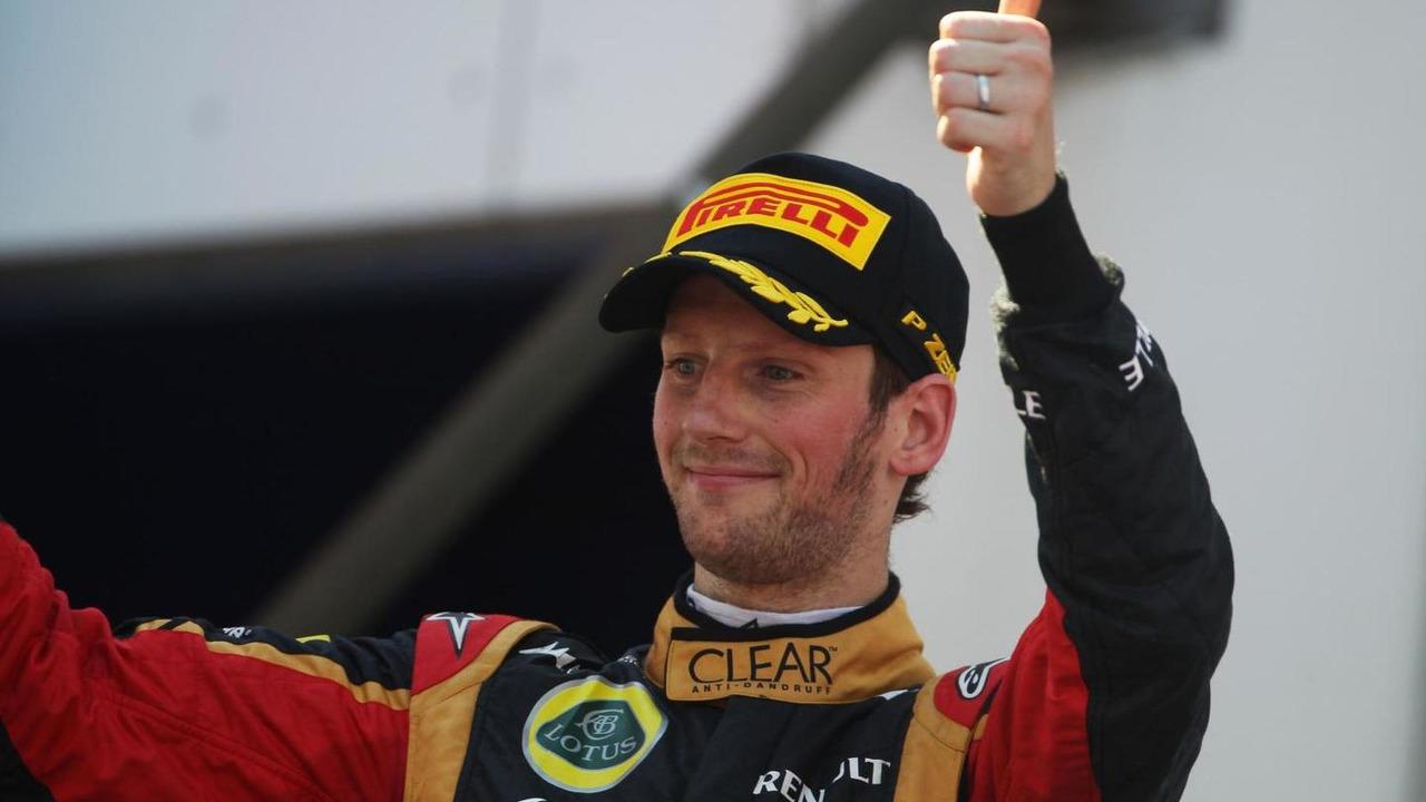 Romain Grosjean (FRA) Lotus F1 Team celebrates his third position on the podium at 2013 German Grand Prix