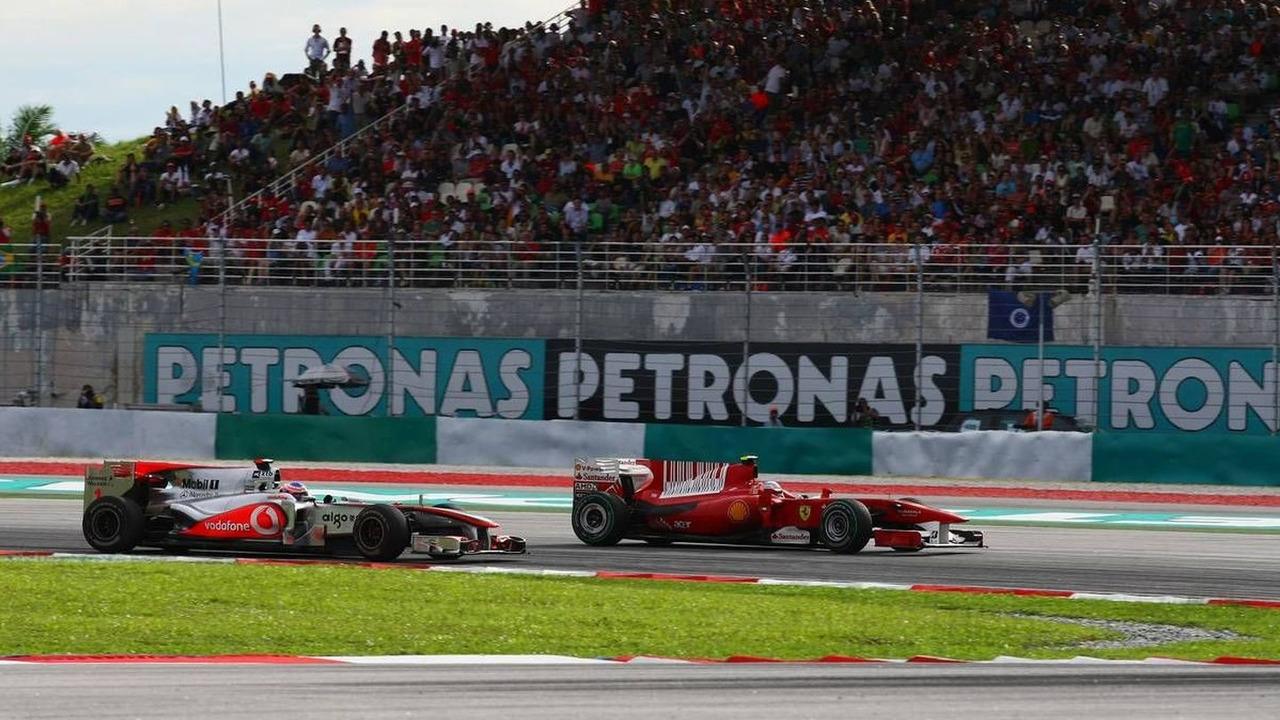Jenson Button (GBR), McLaren Mercedes, Fernando Alonso (ESP), Scuderia Ferrari, Malaysian Grand Prix, 4.04.2010 Kuala Lumpur, Malaysia