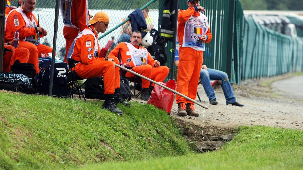 A marshal fishes in a stream near the circuit 24.08.2013 Belgian Grand Prix