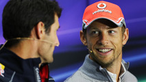 Mark Webber (AUS) Red Bull Racing and Jenson Button (GBR) McLaren in the FIA Press Conference