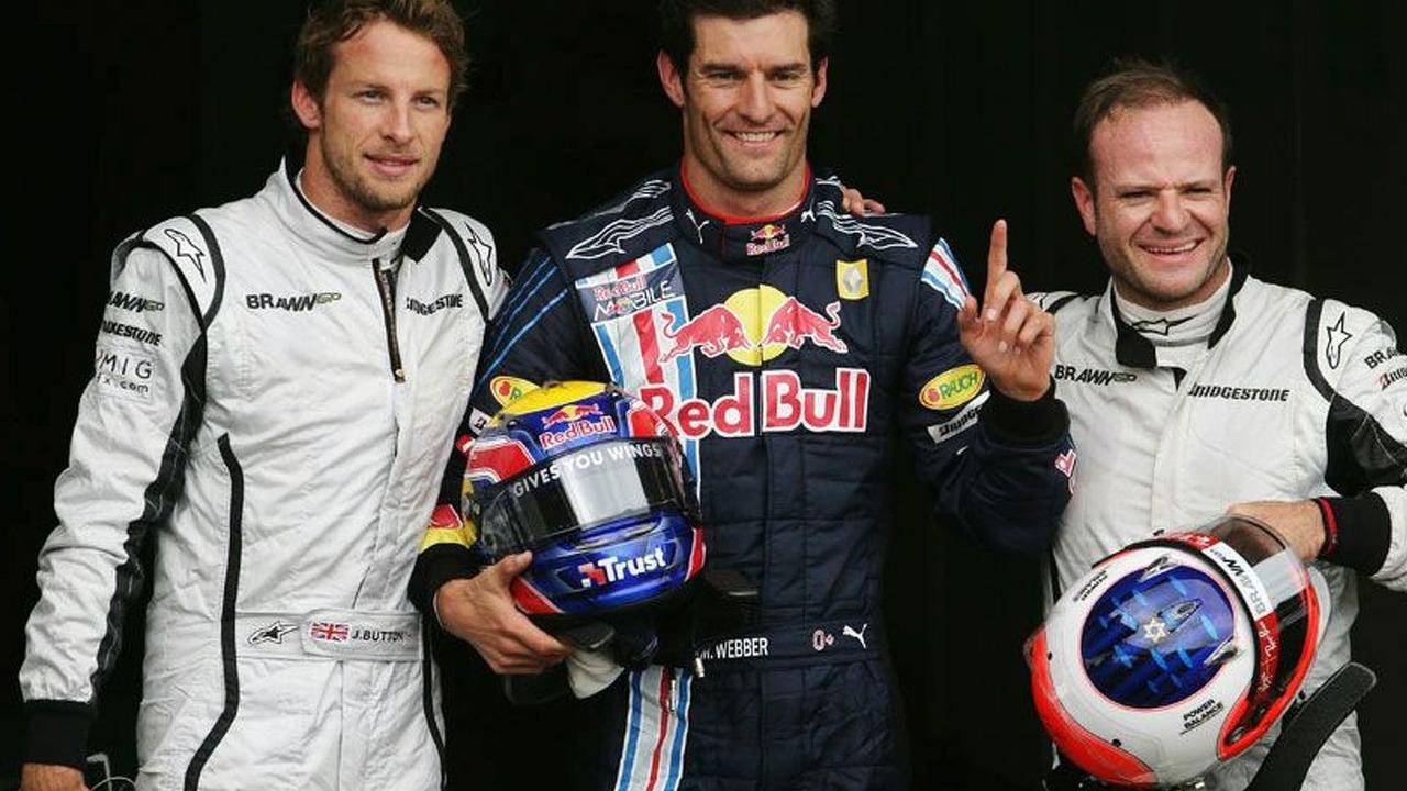 Mark Webber celebrates maiden pole with Jensen button and Rubens Barrichello