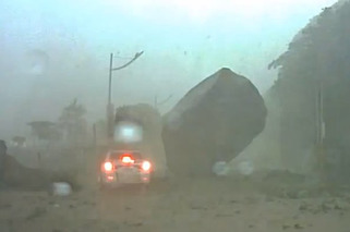 Taiwanese Driver Narrowly Escapes Mudslide, Giant Boulder