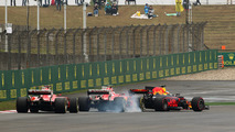 f1-chinese-gp-2017-daniel-ricciardo-red-bull-racing-rb13-leads-a-locked-up-kimi-raikkonen