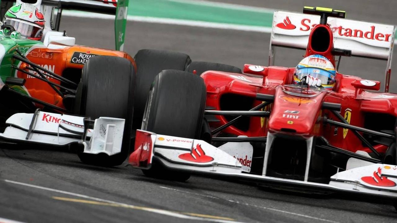 Vitantonio Liuzzi (ITA), Force India F1 Team and Fernando Alonso (ESP), Scuderia Ferrari - Formula 1 World Championship, Rd 13, Belgian Grand Prix, Sunday Race, 29.08.2010 Spa, Belgium