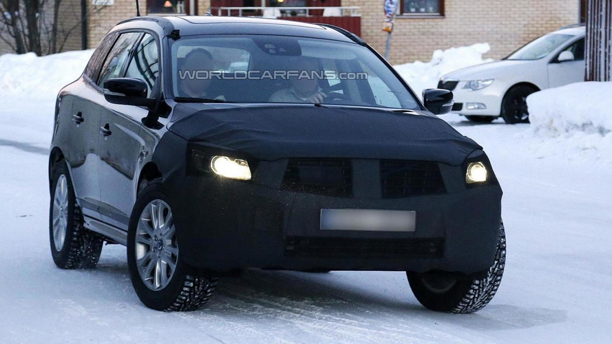 2014 Volvo XC60 facelift spied hiding new front fascia