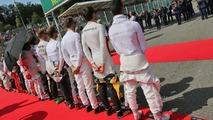 (L to R): Nico Hulkenberg, Sahara Force India F1; Romain Grosjean, Haas F1 Team; Jenson Button, McLaren; Jolyon Palmer, Renault Sport F1 Team; and Pascal Wehrlein, Manor Racing, as the grid observes the national anthem