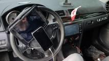 Smartphone and tablet on steering wheel