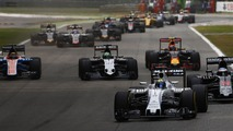 Felipe Massa, Williams FW38 Mercedes, leads Fernando Alonso, McLaren MP4-31 Honda; Nico Hulkenberg, Force India VJM09 Mercedes; Max Verstappen, Red Bull Racing RB12 TAG Heuer and the remainder of the field at the start of the race