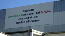 Porsche hang signs during Greenpeace demonstration