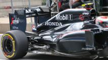 Jenson Button, McLaren MP4-30 engine cover and rear suspension detail
