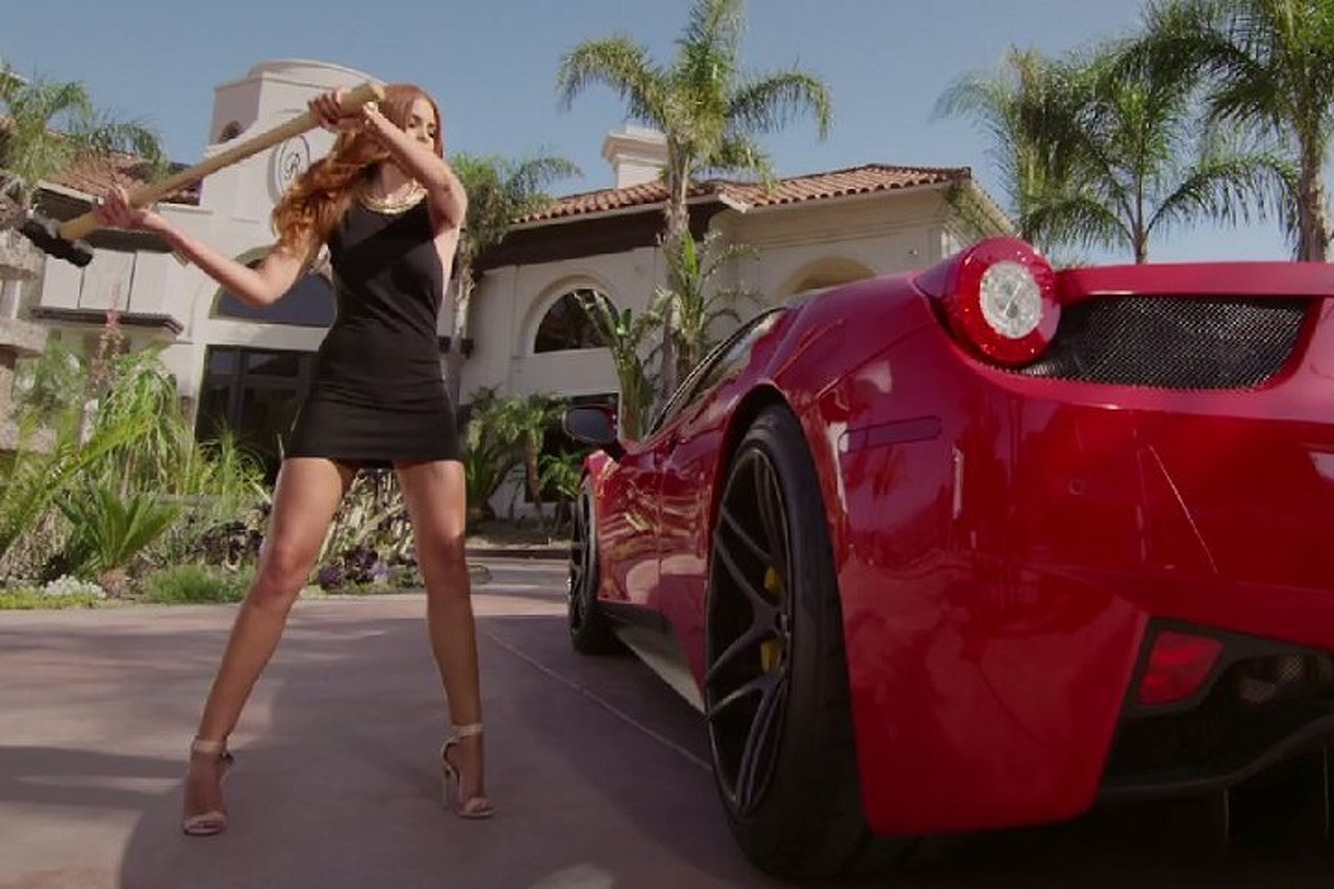 Watch a Supermodel Take a Sledgehammer to a Ferrari 458