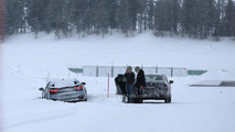 BMW i8 gets stuck in the snow, 2015 7-Series comes to the rescue